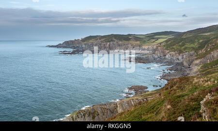 View over Rockham Bay and Bull Point lighthouse near Illfracombe Devon Uk - Stock Image