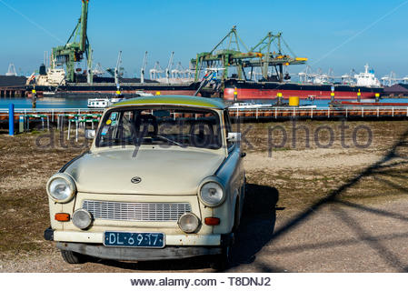 Rotterdam, Netherlands. A Deutsche Democratische Republik build, vintage Trabant (1971) driving around the Port of Rotterdam Harbor area on a sunny, S - Stock Image