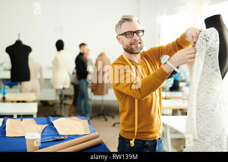 Working over lace dress - Stock Image