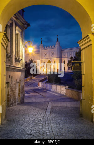 View of Lublin Castle through the arch at dusk in old town of Lublin, Poland - Stock Image