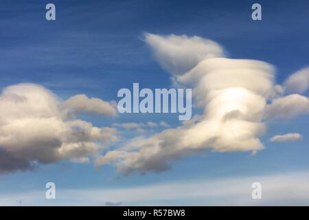 Interesting White Cumulus Clouds Pattern Against the Blue Sky - Stock Image
