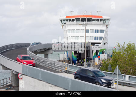 Cars disembarking from the Victoria of Wight ferry at Fishbourne - Stock Image
