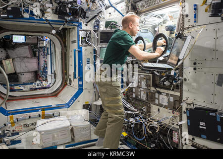 ISS-46 Tim Kopra sets up hardware for the BASS-M experiment in the Destiny lab - Stock Image