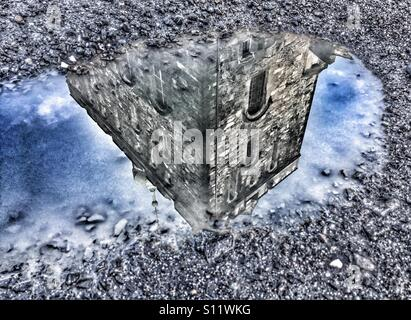 Rozenkrans tower mirrored in a puddle - Stock Image