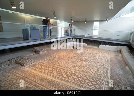 St Albans UK, view of a Roman mosaic floor inside the excavated hypocaust in Verulamium Park, Herfordshire, England. - Stock Image