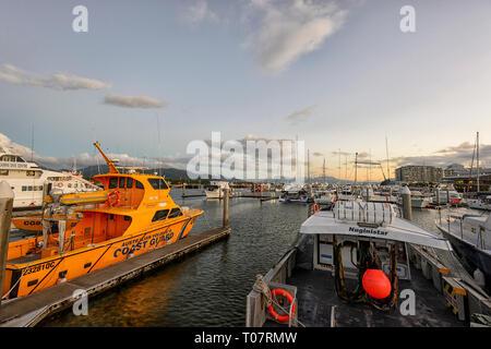 Cairns Marina with Australian Volunteer Coast Guard boat at sunset, Far North Queensland, FNQ, QLD, Australia - Stock Image