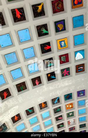 Colorful, handmade ceramic tiles adorn the coffered ceiling of the Miami Brickell Metrorail Station. - Stock Image