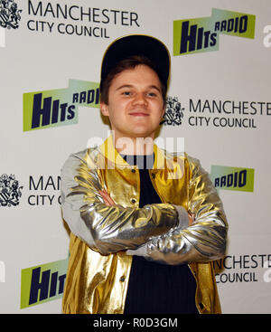 Manchester, UK. 3rd November, 2018. Ryan Heenan plays Billionaire by David Walliams at the Manchester Lights switch on Credit: Della Batchelor/Alamy Live News - Stock Image