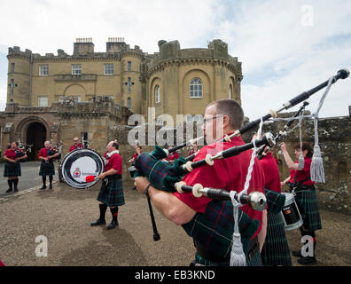 People playing the bagpipes outside Culzean Castle, South Ayrshire, Scotland - Stock Image