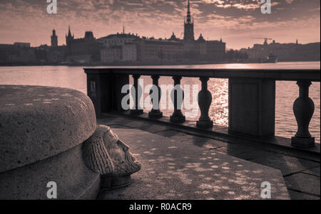Stockholm City Hall garden sculpture monument, with old historic town of Gamla Stan in the background, Stockholm, Sweden. - Stock Image