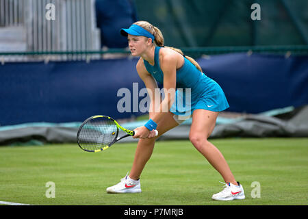 A professional tennis player (Katie Swan) positioned in the ready position during a match. Swan is awaiting a serve from her opponent. - Stock Image