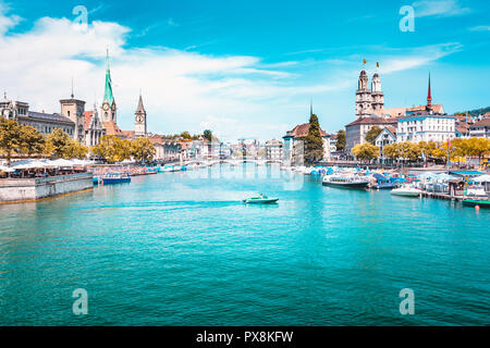 Panoramic view of Zurich city center with churches and boats on beautiful river Limmat in summer, Canton of Zurich, Switzerland - Stock Image