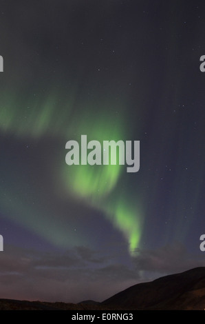 Aurora Borealis or Northern Lights above the Northern Lights Inn, near Grindavik, iceland - Stock Image