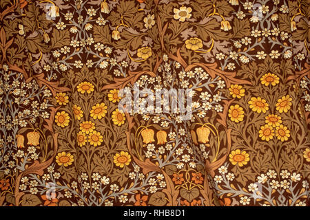 Floral patterned fabricin brown, white and yellow ochre - Stock Image