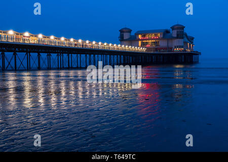 The Grand Pier reaching out into the Bristol Channel at Weston-super-Mare, Somersert England UK. April 2019 - Stock Image