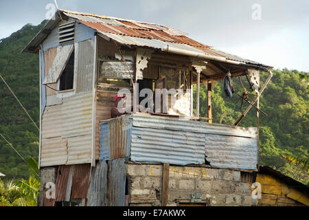 Tin house, the owner also makes metal baking utensils hence his name, 'tin man'- he also has police man - Stock Image