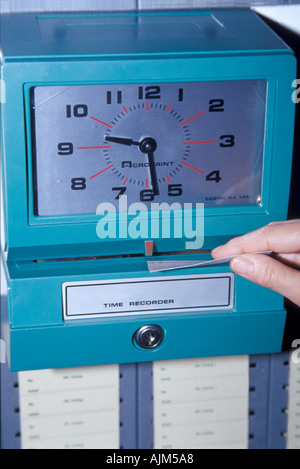 Workers time recorder checking coming and going the working place England 2000 - Stock Image