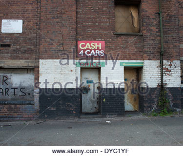 Vehicle dismantlers office in disused, and partially derelict, warehouse near Bootle docks, Mersetside, UK - Stock Image