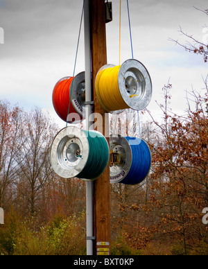 colorful Polemaster telephone cable attached to telephone pole - Stock Image