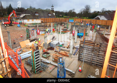 Looking down on commercial building construction site. - Stock Image