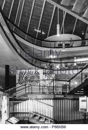 London 1960s.  The interior atrium of the Commonwealth Institute, Kensington, London, UK – designed by John Pawson and opened in 1962, and photographed in November 1967 – 1960s (1967) - Stock Image