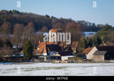 Fingest Church, St. Bartholomew's, in Winter with snow on the ground. - Stock Image