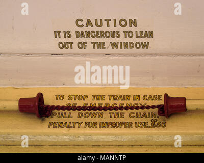 Caution Notice and Communication Cord inside Open Carriage on the Vale of Rheidol Railway - Stock Image