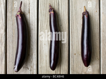 Three ichiban, or Japanese, eggplants - Stock Image