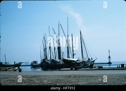 Native schooners in the old harbor; Jakarta, Java, Indonesia. - Stock Image