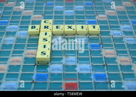 Brexit Crisis written with Scrabble tiles - Stock Image