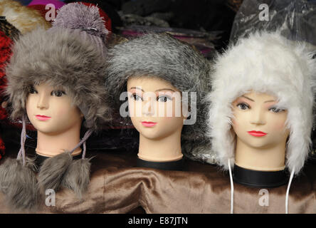 mannequin heads displaying hats for sale, Leicester Market, Leicester, England, UK - Stock Image