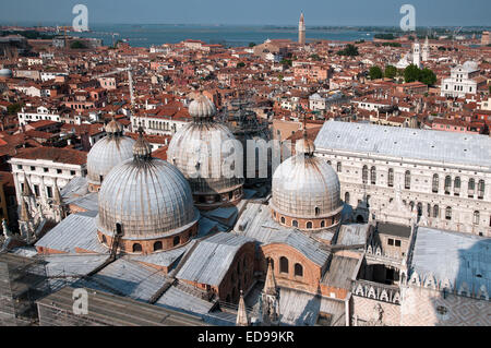 Domes of Basilica di San Marco St Marks and part of Doges Palace seen from top of St Marks Bell Tower Venice Italy - Stock Image