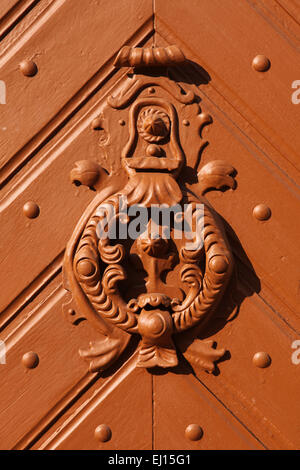 Knocker at the door Mohacs, Hungary. - Stock Image