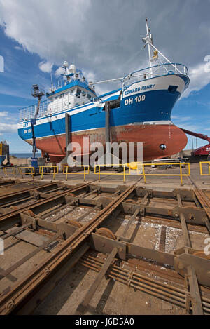 Crab Fishing boat Edward Henry (DH 100) in the Macduff boat yard for a repaint after a hard seasons work. - Stock Image