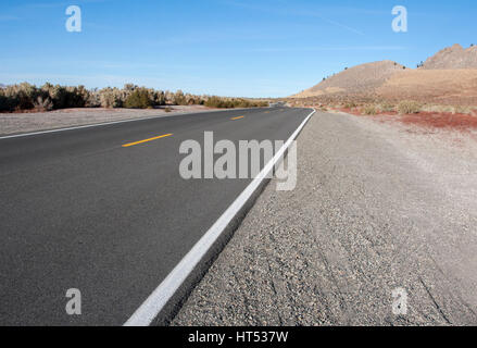 Taking a drive on Highway 120, going east past the Mono Craters and Mono Lake, in Mono County, California. - Stock Image