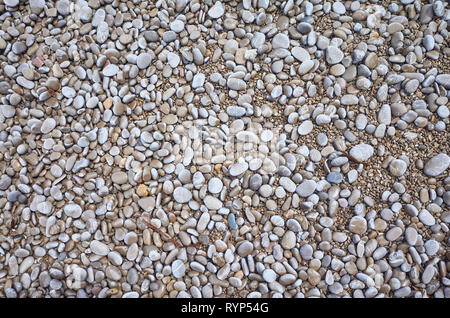Natural background made of small pebbles on a beach. - Stock Image