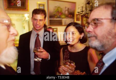 Coral Gables Miami Florida wedding reception in home bride & groom listen to guest conversation - Stock Image