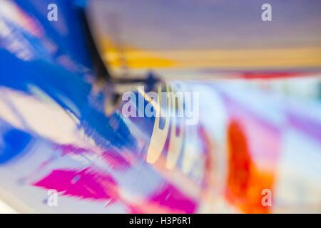 Aircraft fuselage artistic arty surface intensive color - Stock Image