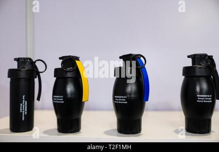February 18, 2019 - Abu Dhabi, UAE: Blue Red and Green Smoke Hand Grenade - Stock Image