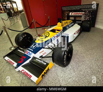 Nigel Mansell's Williams FW11 Formula One Car, which he raced during the 1986 season, narrowly missing out on the Championship after a tyre blow-out - Stock Image