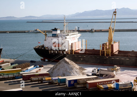 Shipment of salt at Cagliari Dockside, Sardinia, Cagliari Port Sardinia truck lorry ship shipping hold container transport - Stock Image