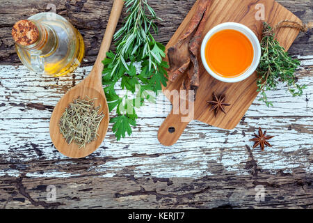 Assortment of herbs rosemary ,thyme,sage and parsley set up with wooden background concept for international cuisine. - Stock Image