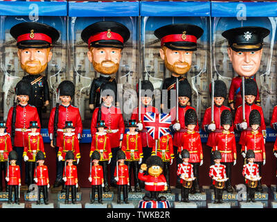 The Royal Family - Prince William and Prince Harry toys and souvenirs for sale in a London Souvenir Shop - Stock Image
