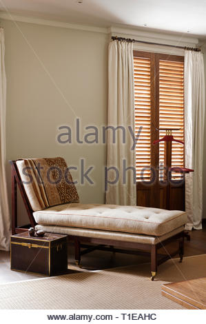 Trunk by recliner - Stock Image