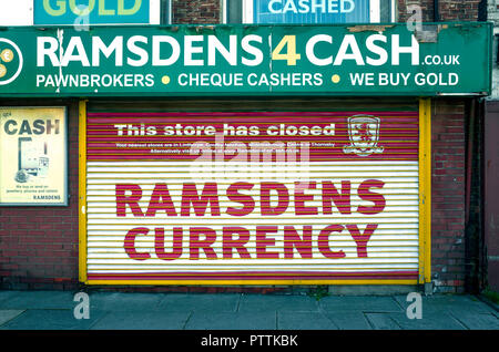 Ramsdens chain Pawnbroker shop now closed with a decorated roller blind  captioned Ramsdens Currency This store is now closed - Stock Image