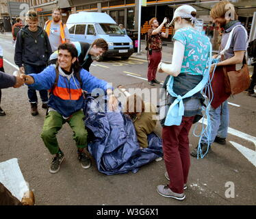 Glasgow, Scotland, UK. 15th July, 2019. Extinction Rebellion Summer Uprising that saw more police than people at the end, d at 8pm with Mondays planned stint involving a purple boat they lowered their mast and went home for dinner. Credit: gerard ferry/Alamy Live News - Stock Image