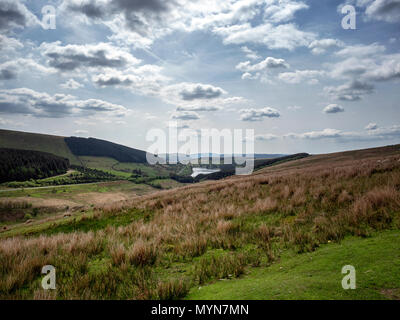 Moorland hills of the Brecon Beacons on the A4059 with Llwyn-on Reservoir and Merthyr Tydfil, south Wales, in the distance - Stock Image