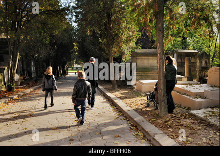 Paris, France - Street Scene, Young Family Promenading in 'Pere Lachaise Cemetery', Autumn - Stock Image