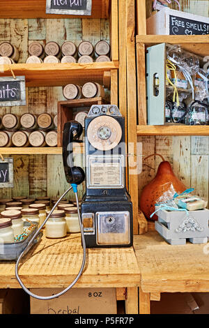 Mid 1960s or 1970s dial pay telephone or payphone on display in a country roadside store or market in Pike Road Alabama, USA. - Stock Image
