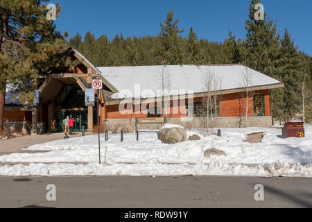 Truckee, CA , USA - January 14, 2019: Entrance of the Donner Memorial State Park Visitors center on a winters day with accumulated snow and blue sky - Stock Image